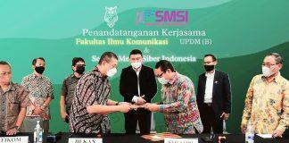 Penandatanganan kerjasama fakultas ilmu komunikasi UPDM (B) dengan SMSI