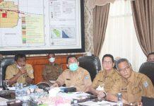 Walikota Binjai Drs.H.Amir Hamzah,M. AP saat menghadiri rapat evaluasi realisasi pajak daerah dan retribusi daerah Kota Binjai